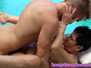 European granny cockriding outdoors