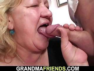 Busty fat grandma guzzles 2 cocks at once