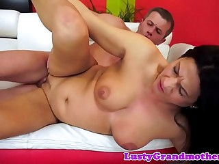 Busty granny sucks and fucks hard cock