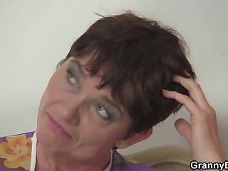 Hot 60 years old woman in stockings spreads legs