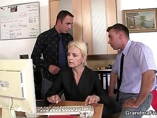 Thin blonde old grandma swallows two cocks