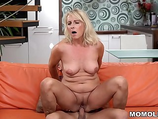 Blonde mature and her youthful lover