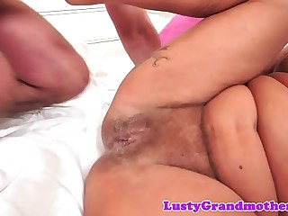 Tattooed mature gets fucked on the bed