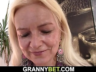 Blondehaired lean granny rides big meat