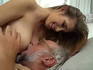 Youthful angel wakes up her old stud to have lovemaking