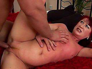 Aged redhead gal Esmeralda is devouring penis