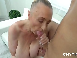 Granny with fat tits fucks with a fat rock hard cock