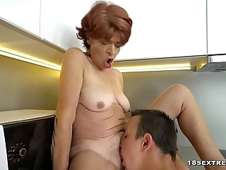 Guy fucking a hairy granny cootchie in the kitchen