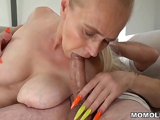 Mother with long nails rides a thick dick